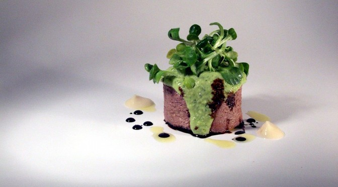 Veal tongue with emulsion of gree sauce