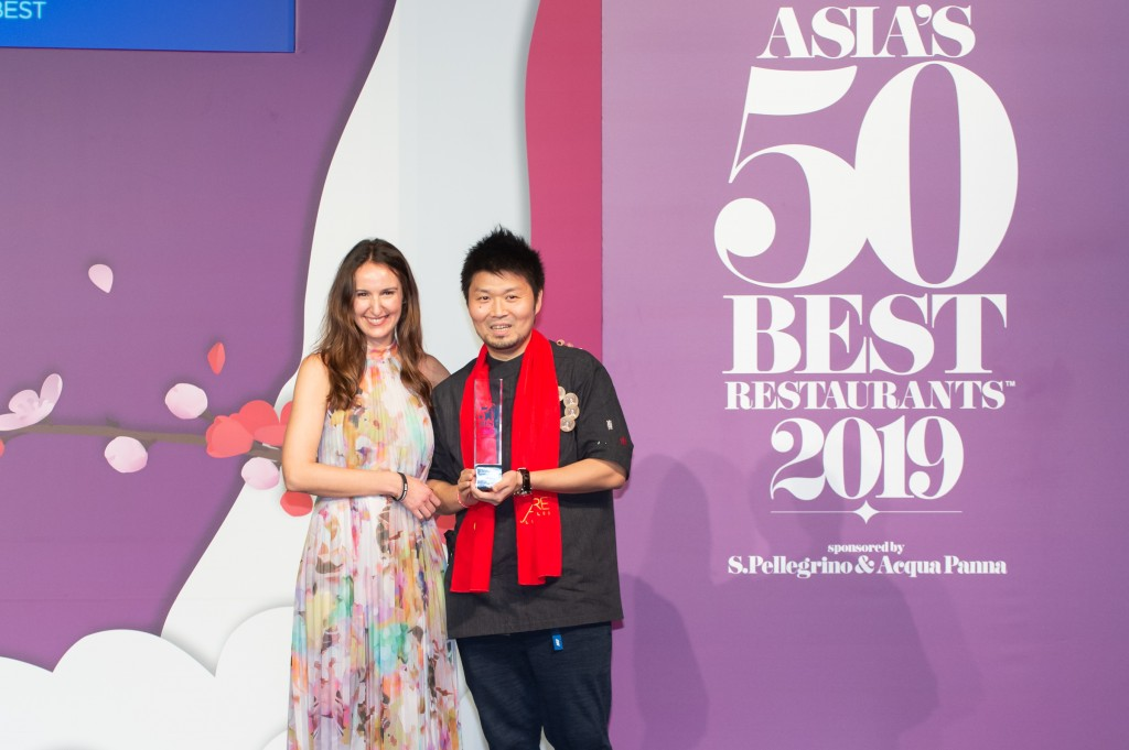 Zaiyu Hasegawa, winner of the Chefs' Choice Award, sponsored by Estrella Damm, with Maria Faus, Marketing Manager Asia & Pacific, Estrella Damm