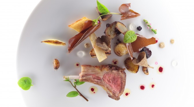 Oven roasted lamb filet. Almond,  capers and olives with roasted pepper j...