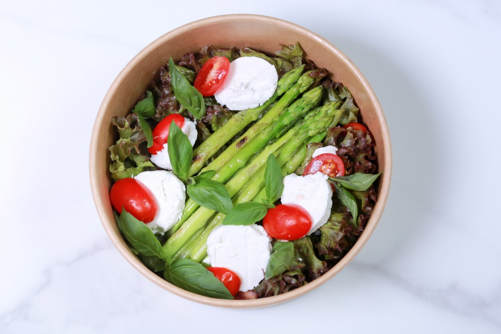 Grilled asparagus, fresh herbs, goat cheese, candied tomatoes,  balsamic dressing